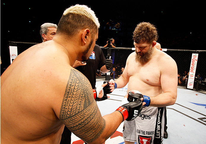 SAITAMA, JAPAN - SEPTEMBER 20: (L to R) Mark Hunt and Roy Nelson touch gloves before their heavyweight bout during the UFC Fight Night event inside the Saitama Arena on September 20, 2014 in Saitama, Japan. (Photo by Mitch Viquez/Zuffa LLC/Zuffa LLC via G