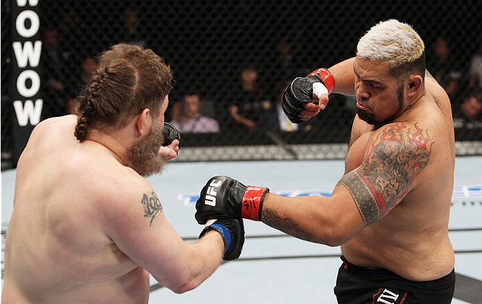 SAITAMA, JAPAN - SEPTEMBER 20:  Mark Hunt loads up to throw a punch on Roy Nelson in their heavyweight bout during the UFC Fight Night event inside the Saitama Arena on September 20, 2014 in Saitama, Japan. (Photo by Mitch Viquez/Zuffa LLC/Zuffa LLC via G