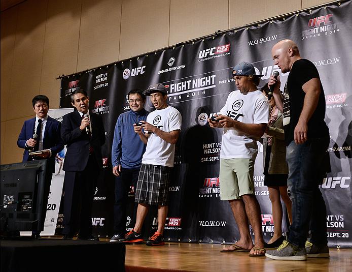 TOKYO, JAPAN - SEPTEMBER 17:  Takeya Mizugaki and Urijah Faber (White T-Shirt) play the new EA UFC video game during the UFC Ultimate Media Day at the Hilton Tokyo on September 17, 2014 in Tokyo, Japan.  (Photo by Keith Tsuji/Zuffa LLC/Zuffa LLC via Getty