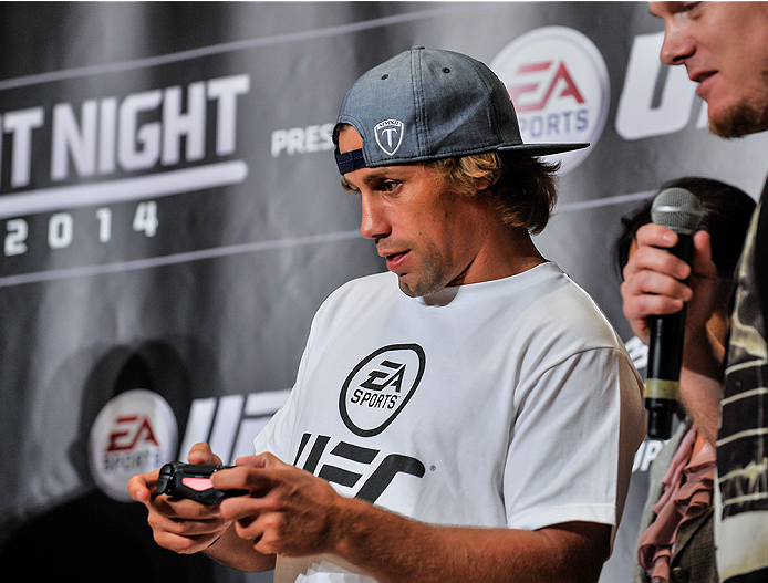 TOKYO, JAPAN - SEPTEMBER 17:  Urijah Faber plays the new EA UFC video game during the UFC Ultimate Media Day at the Hilton Tokyo on September 17, 2014 in Tokyo, Japan.  (Photo by Keith Tsuji/Zuffa LLC/Zuffa LLC via Getty Images)