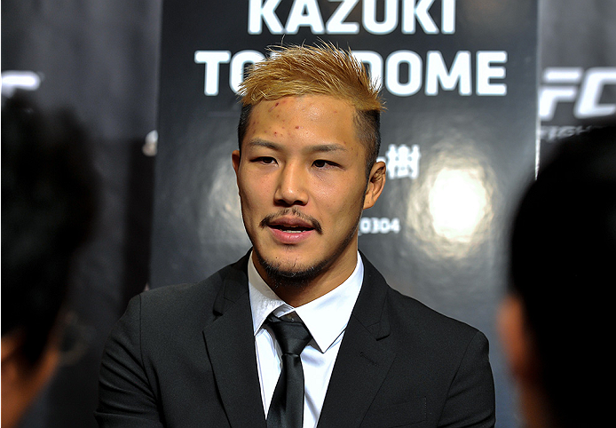 TOKYO, JAPAN - SEPTEMBER 17:  Kazuki Tokudome interacts with media during the UFC Ultimate Media Day at the Hilton Tokyo on September 17, 2014 in Tokyo, Japan.  (Photo by Keith Tsuji/Zuffa LLC/Zuffa LLC via Getty Images)