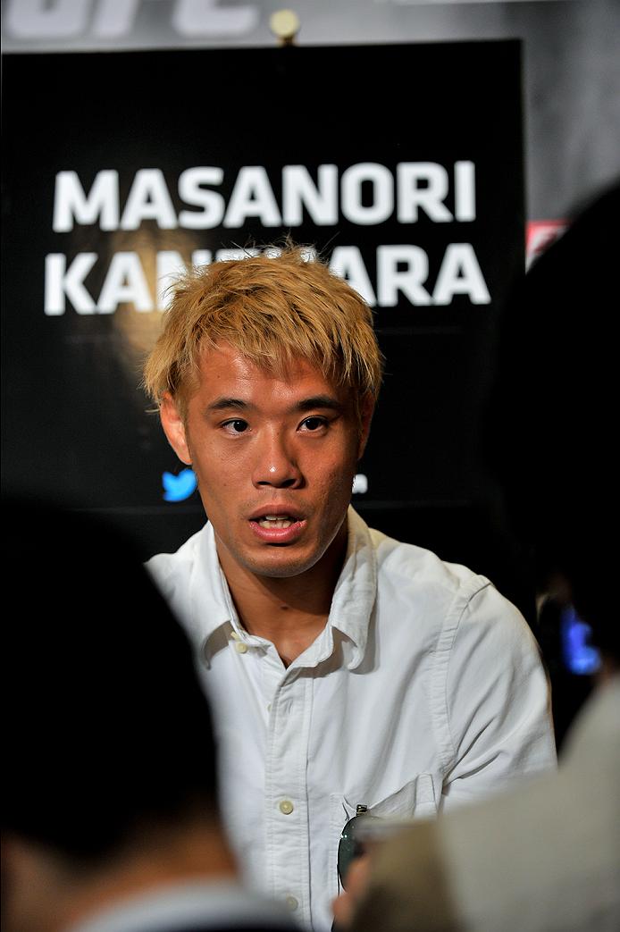 TOKYO, JAPAN - SEPTEMBER 17:  Masanori Kanehara interacts with media during the UFC Ultimate Media Day at the Hilton Tokyo on September 17, 2014 in Tokyo, Japan.  (Photo by Keith Tsuji/Zuffa LLC/Zuffa LLC via Getty Images)