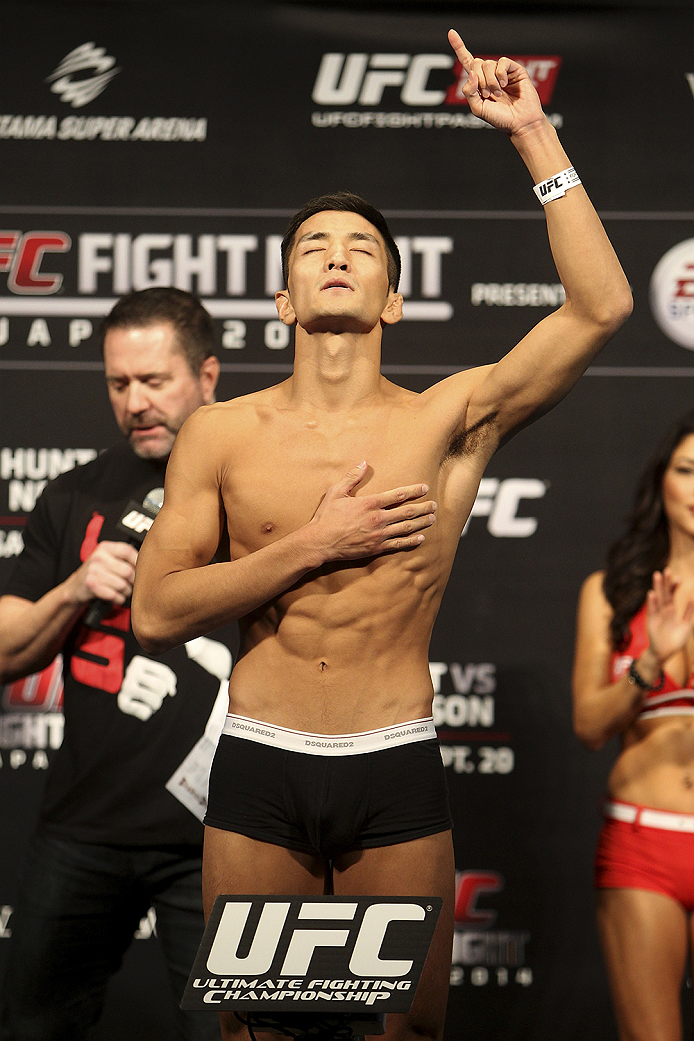 SAITAMA, JAPAN - SEPTEMBER 19:  Kyung Ho Kang steps on the scale during the UFC Fight Night weigh-in event on September 19, 2014 in Saitama, Japan. (Photo by Mitch Viquez/Zuffa LLC/Zuffa LLC via Getty Images)