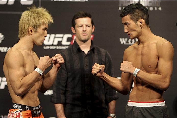 SAITAMA, JAPAN - SEPTEMBER 19:  (L and R) Michinori Tanaka and Kyung Ho Kang during the UFC Fight Night weigh-in event on September 19, 2014 in Saitama, Japan. (Photo by Mitch Viquez/Zuffa LLC/Zuffa LLC via Getty Images)