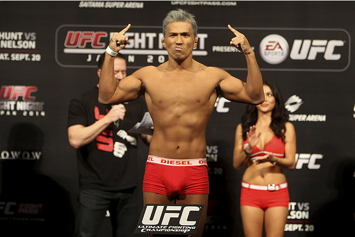 SAITAMA, JAPAN - SEPTEMBER 19:  Takenori Sato steps on the scale during the UFC Fight Night weigh-in event on September 19, 2014 in Saitama, Japan. (Photo by Mitch Viquez/Zuffa LLC/Zuffa LLC via Getty Images)
