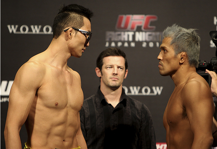 SAITAMA, JAPAN - SEPTEMBER 19:  (L and R) Hyun Gyu Lim and Takenori Sato during the UFC Fight Night weigh-in event on September 19, 2014 in Saitama, Japan. (Photo by Mitch Viquez/Zuffa LLC/Zuffa LLC via Getty Images)
