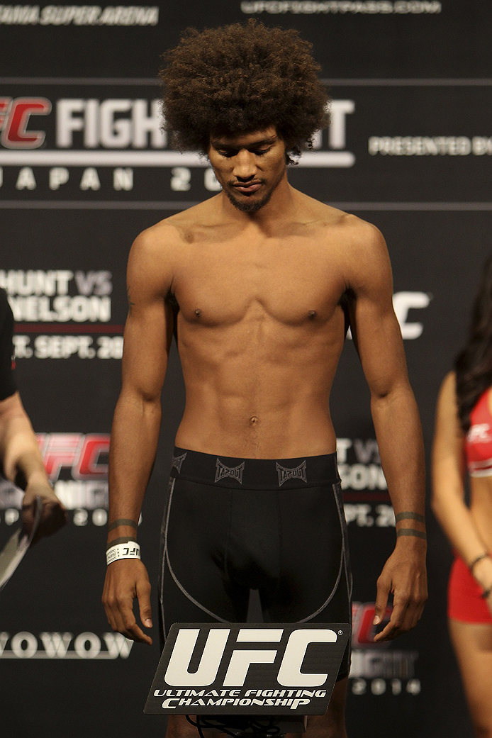 SAITAMA, JAPAN - SEPTEMBER 19:  Alex Caceres steps on the scale during the UFC Fight Night weigh-in event on September 19, 2014 in Saitama, Japan. (Photo by Mitch Viquez/Zuffa LLC/Zuffa LLC via Getty Images)