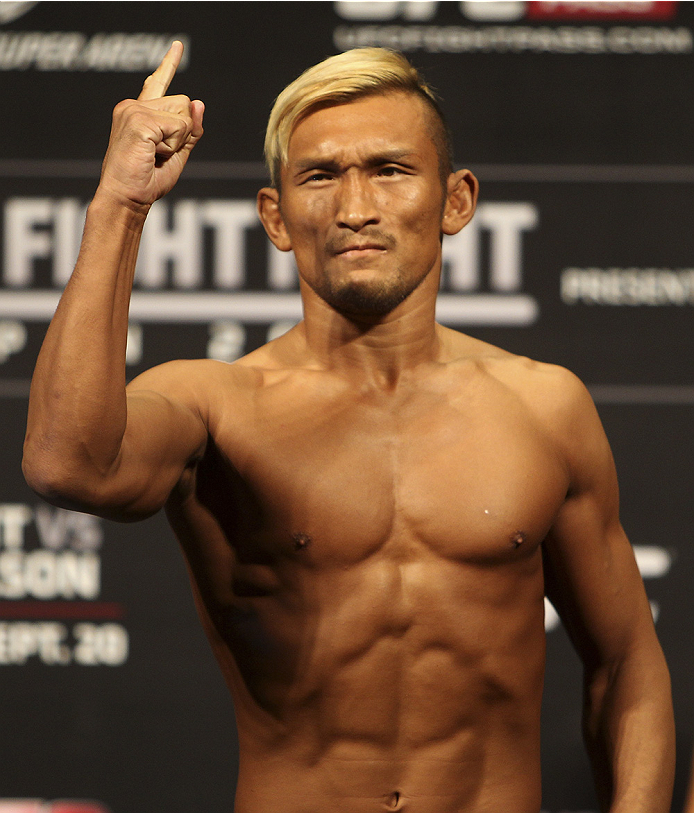 SAITAMA, JAPAN - SEPTEMBER 19: Kiichi Kunimoto steps on the scale during the UFC Fight Night weigh-in event on September 19, 2014 in Saitama, Japan. (Photo by Mitch Viquez/Zuffa LLC/Zuffa LLC via Getty Images)