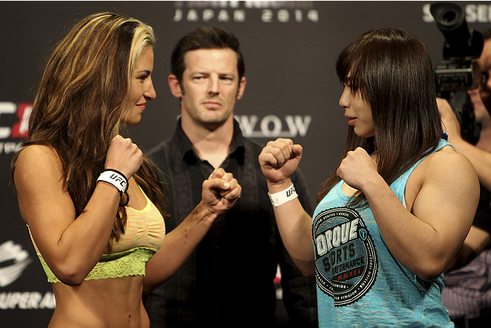 SAITAMA, JAPAN - SEPTEMBER 19: (L and R) Miesha Tate and Rin Nakai during the UFC Fight Night weigh-in event on September 19, 2014 in Saitama, Japan. (Photo by Mitch Viquez/Zuffa LLC/Zuffa LLC via Getty Images)