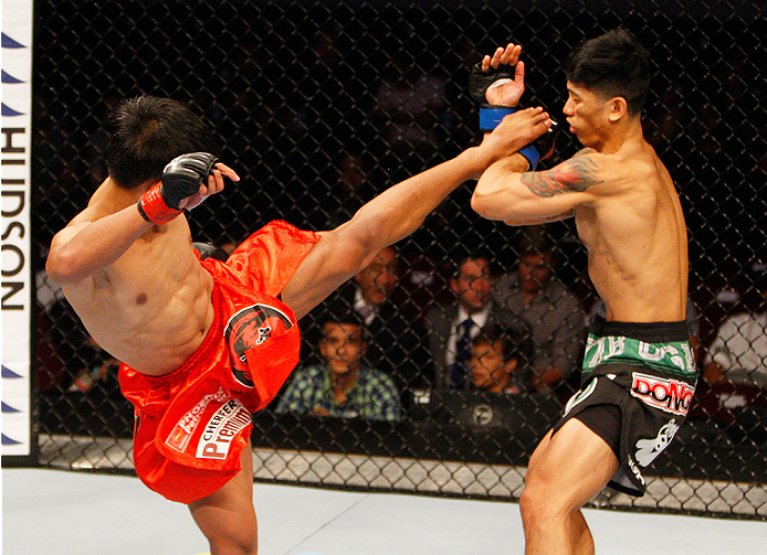 MANILA, PHILIPPINES - MAY 16:  Roldan Sangcha-An of the Philippines kicks Jon Delos Reyes of Guam in their flyweight fight during the UFC Fight Night event at the Mall of Asia Arena on May 16, 2015 in Manila, Philippines. (Photo by Mitch Viquez/Zuffa LLC/
