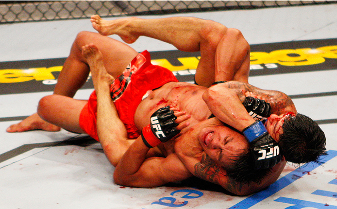 MANILA, PHILIPPINES - MAY 16:  Jon Delos Reyes of Guam locks in a submission on Roldan Sangcha-An of the Philippines in their flyweight fight during the UFC Fight Night event at the Mall of Asia Arena on May 16, 2015 in Manila, Philippines. (Photo by Mitc