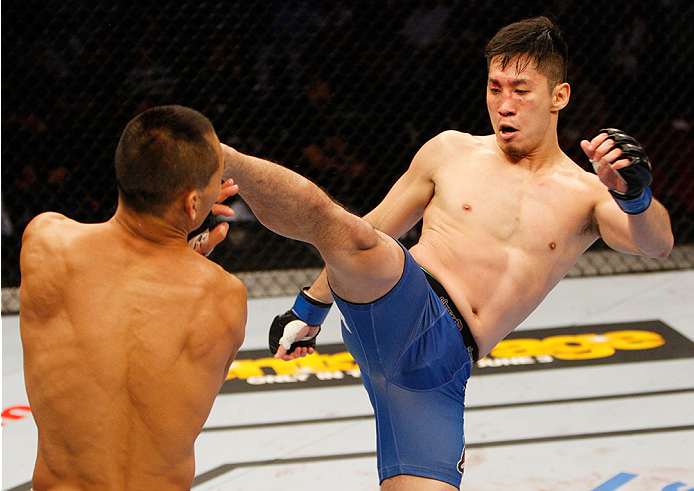 MANILA, PHILIPPINES - MAY 16:  Royston Wee of Singapore throws a kick at Ning Guangyou of China in their bantamweight fight during the UFC Fight Night event at the Mall of Asia Arena on May 16, 2015 in Manila, Philippines. (Photo by Mitch Viquez/Zuffa LLC