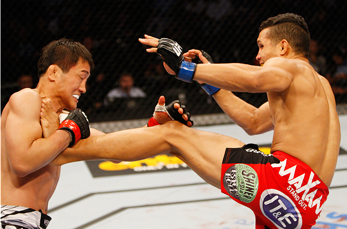 MANILA, PHILIPPINES - MAY 16: Tae Hyun Bang of South Korea goes catches the kick of Jon Tuck of Guam in their lightweight fight during the UFC Fight Night event at the Mall of Asia Arena on May 16, 2015 in Manila, Philippines. (Photo by Mitch Viquez/Zuffa