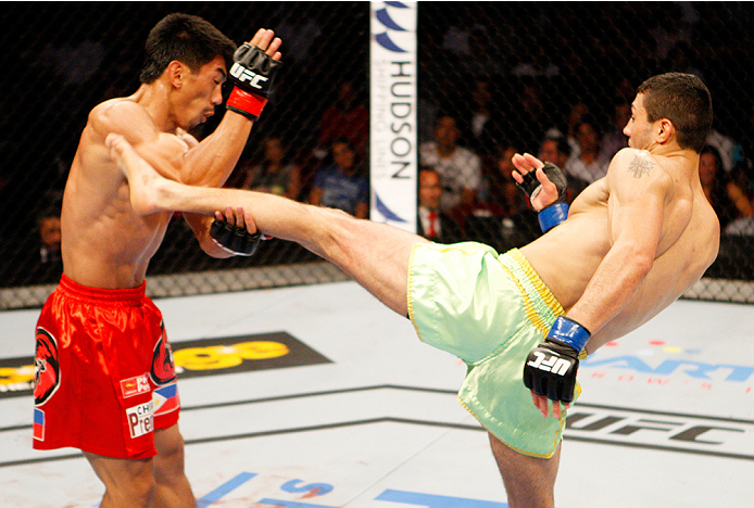 MANILA, PHILIPPINES - MAY 16: Levan Makashvili of the United States goes for a kick on Mark Eddiva of the Philippines  in their featherweight fight during the UFC Fight Night event at the Mall of Asia Arena on May 16, 2015 in Manila, Philippines. (Photo b