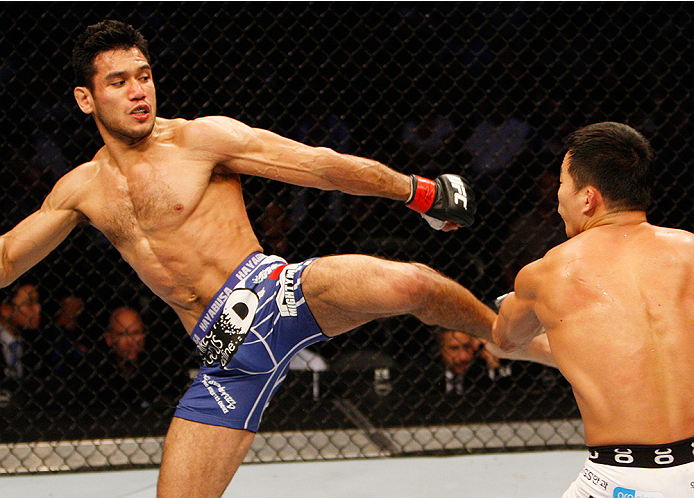 MANILA, PHILIPPINES - MAY 16: Phillipe Nover of the United States kicks Yui Chul Nam of South Korea in their featherweight fight during the UFC Fight Night event at the Mall of Asia Arena on May 16, 2015 in Manila, Philippines. (Photo by Mitch Viquez/Zuff