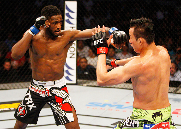 MANILA, PHILIPPINES - MAY 16: Neil Magny of the United States throws a punch at Hyun Gyu Lim of South Korea in their welterweight fight during the UFC Fight Night event at the Mall of Asia Arena on May 16, 2015 in Manila, Philippines. (Photo by Mitch Viqu