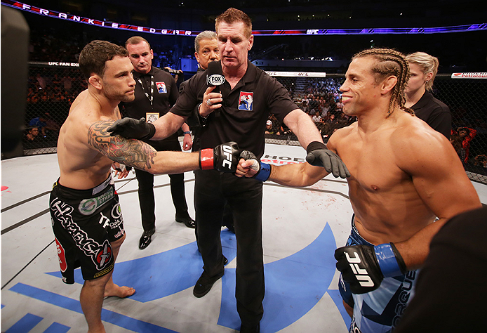 MANILA, PHILIPPINES - MAY 16: (L to R) Frankie Edgar of the United States and Uriah Faber of the United States touch gloves before  their featherweight fight during the UFC Fight Night event at the Mall of Asia Arena on May 16, 2015 in Manila, Philippines
