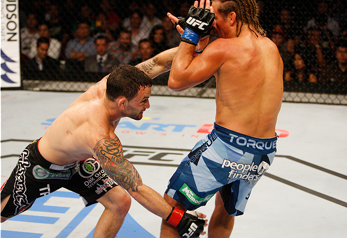 MANILA, PHILIPPINES - MAY 16:  Frankie Edgar of the United States takes down Uriah Faber of the United States in their featherweight fight during the UFC Fight Night event at the Mall of Asia Arena on May 16, 2015 in Manila, Philippines. (Photo by Mitch V