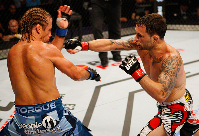 MANILA, PHILIPPINES - MAY 16: Frankie Edgar of the United States throws a punch at Uriah Faber of the United States in their featherweight fight during the UFC Fight Night event at the Mall of Asia Arena on May 16, 2015 in Manila, Philippines. (Photo by M