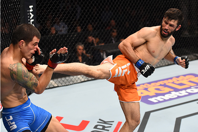 MONTERREY, MEXICO - NOVEMBER 21:  (R-L) Polo Reyes of Mexico kicks Cesar Arzamendia of Paraguay in their lightweight bout during the UFC Fight Night event at Arena Monterrey on November 21, 2015 in Monterrey, Mexico.  (Photo by Jeff Bottari/Zuffa LLC/Zuff