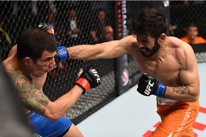 MONTERREY, MEXICO - NOVEMBER 21:  (R-L) Polo Reyes of Mexico punches Cesar Arzamendia of Paraguay in their lightweight bout during the UFC Fight Night event at Arena Monterrey on November 21, 2015 in Monterrey, Mexico.  (Photo by Jeff Bottari/Zuffa LLC/Zu