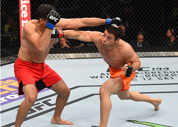 MONTERREY, MEXICO - NOVEMBER 21:  (R-L) Vernon Ramos of Panama and Alvaro Herrera of Mexico trade punches in their welterweight bout during the UFC Fight Night event at Arena Monterrey on November 21, 2015 in Monterrey, Mexico.  (Photo by Jeff Bottari/Zuf