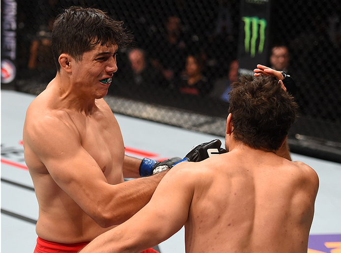MONTERREY, MEXICO - NOVEMBER 21:  (L-R) Alvaro Herrera of Mexico knocks out Vernon Ramos of Panama in their welterweight bout during the UFC Fight Night event at Arena Monterrey on November 21, 2015 in Monterrey, Mexico.  (Photo by Jeff Bottari/Zuffa LLC/