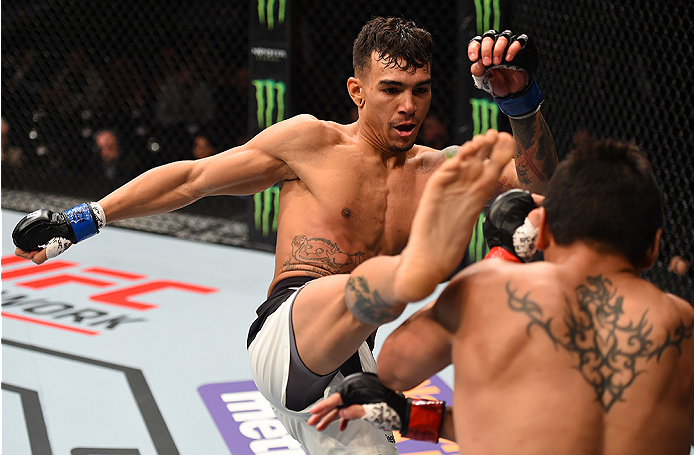 MONTERREY, MEXICO - NOVEMBER 21:  (L-R) Andre Fili of the United States kicks Gabriel Benitez of Mexico in their featherweight bout during the UFC Fight Night event at Arena Monterrey on November 21, 2015 in Monterrey, Mexico.  (Photo by Jeff Bottari/Zuff