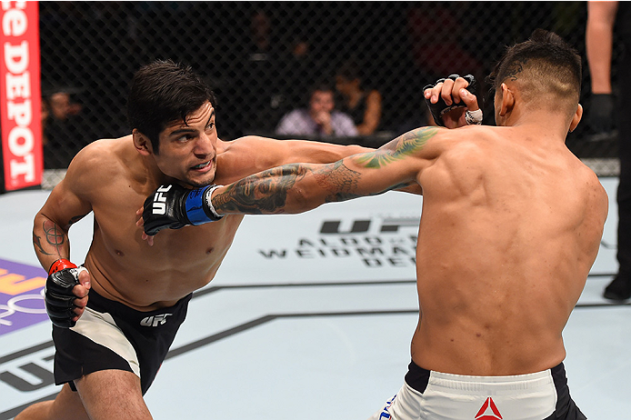 MONTERREY, MEXICO - NOVEMBER 21:  (L-R) Gabriel Benitez of Mexico punches Andre Fili of the United States in their featherweight bout during the UFC Fight Night event at Arena Monterrey on November 21, 2015 in Monterrey, Mexico.  (Photo by Jeff Bottari/Zu
