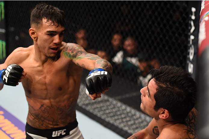 MONTERREY, MEXICO - NOVEMBER 21:  (L-R) Andre Fili of the United States punches Gabriel Benitez of Mexico in their featherweight bout during the UFC Fight Night event at Arena Monterrey on November 21, 2015 in Monterrey, Mexico.  (Photo by Jeff Bottari/Zu