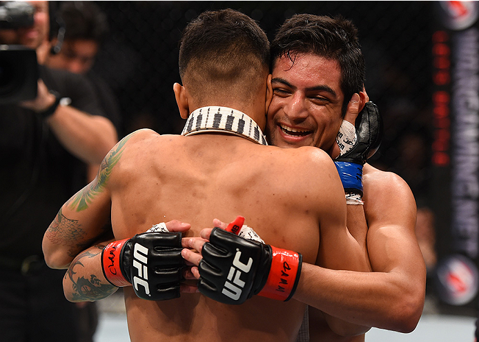 MONTERREY, MEXICO - NOVEMBER 21:  (R-L) Gabriel Benitez of Mexico congratulates opponent Andre Fili of the United States after Fili's knockout victory over Benitez in their featherweight bout during the UFC Fight Night event at Arena Monterrey on November