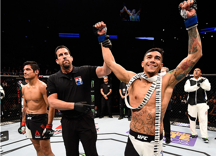 MONTERREY, MEXICO - NOVEMBER 21:  Andre Fili of the United States celebrates after his knockout victory over Gabriel Benitez of Mexico in their featherweight bout during the UFC Fight Night event at Arena Monterrey on November 21, 2015 in Monterrey, Mexic