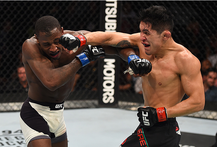 MONTERREY, MEXICO - NOVEMBER 21:  (R-L) Erik Perez of Mexico and Taylor Lapilus of France trade punches in their bantamweight bout during the UFC Fight Night event at Arena Monterrey on November 21, 2015 in Monterrey, Mexico.  (Photo by Jeff Bottari/Zuffa