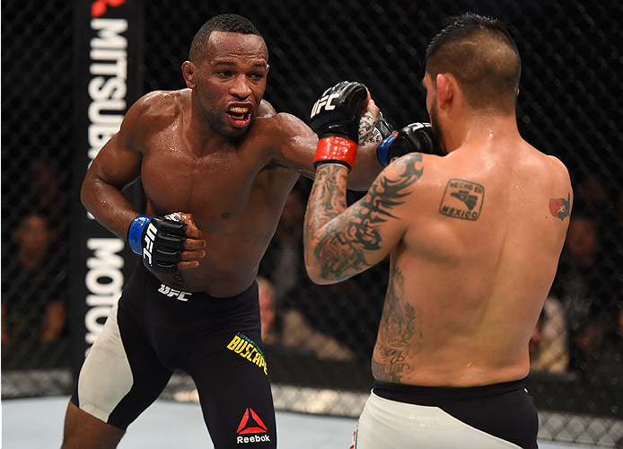 MONTERREY, MEXICO - NOVEMBER 21:  (L-R) Leandro Silva of Brazil punches Efrain Escudero of Mexico in their lightweight bout during the UFC Fight Night event at Arena Monterrey on November 21, 2015 in Monterrey, Mexico.  (Photo by Jeff Bottari/Zuffa LLC/Zu