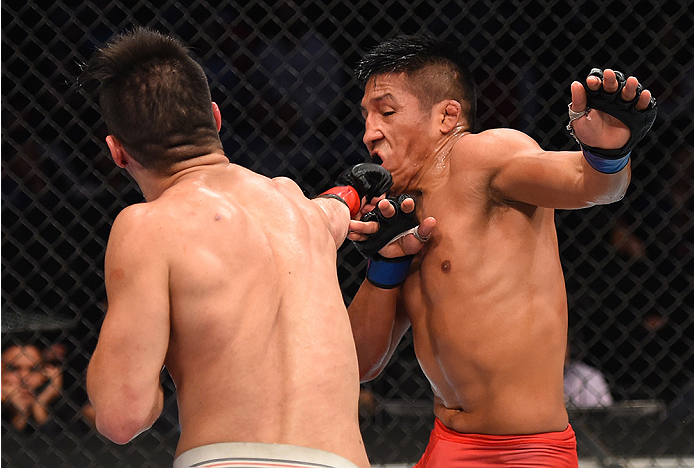 MONTERREY, MEXICO - NOVEMBER 21:  (L-R) Horacio Gutierrez of Mexico punches Enrique Barzola of Peru in their lightweight bout during the UFC Fight Night event at Arena Monterrey on November 21, 2015 in Monterrey, Mexico.  (Photo by Jeff Bottari/Zuffa LLC/