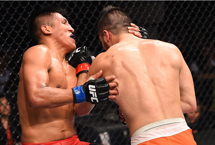 MONTERREY, MEXICO - NOVEMBER 21:  (R-L) Horacio Gutierrez of Mexico punches Enrique Barzola of Peru in their lightweight bout during the UFC Fight Night event at Arena Monterrey on November 21, 2015 in Monterrey, Mexico.  (Photo by Jeff Bottari/Zuffa LLC/
