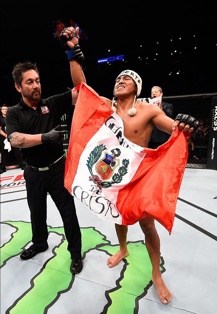 MONTERREY, MEXICO - NOVEMBER 21:  Enrique Barzola of Peru celebrates after his victory over Horacio Gutierrez during the UFC Fight Night event at Arena Monterrey on November 21, 2015 in Monterrey, Mexico.  (Photo by Jeff Bottari/Zuffa LLC/Zuffa LLC via Ge