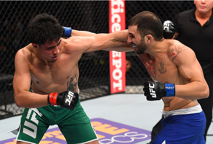 MONTERREY, MEXICO - NOVEMBER 21:  (R-L) Enrique Marin of Spain and Erick Montano of Mexico trade punches in their welterweight bout during the UFC Fight Night event at Arena Monterrey on November 21, 2015 in Monterrey, Mexico.  (Photo by Jeff Bottari/Zuff