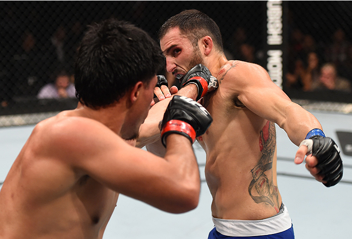 MONTERREY, MEXICO - NOVEMBER 21:  (L-R) Erick Montano of Mexico punches Enrique Marin of Spain in their welterweight bout during the UFC Fight Night event at Arena Monterrey on November 21, 2015 in Monterrey, Mexico.  (Photo by Jeff Bottari/Zuffa LLC/Zuff