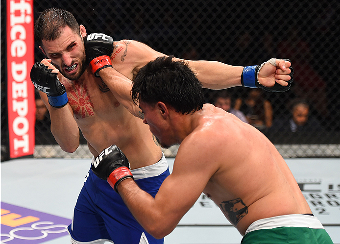 MONTERREY, MEXICO - NOVEMBER 21:  (R-L) Erick Montano of Mexico punches Enrique Marin of Spain in their welterweight bout during the UFC Fight Night event at Arena Monterrey on November 21, 2015 in Monterrey, Mexico.  (Photo by Jeff Bottari/Zuffa LLC/Zuff