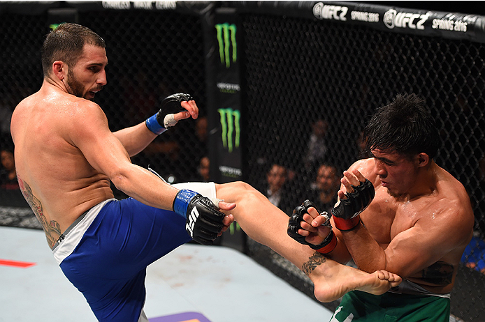 MONTERREY, MEXICO - NOVEMBER 21:  (L-R) Enrique Marin of Spain kicks Erick Montano of Mexico in their welterweight bout during the UFC Fight Night event at Arena Monterrey on November 21, 2015 in Monterrey, Mexico.  (Photo by Jeff Bottari/Zuffa LLC/Zuffa