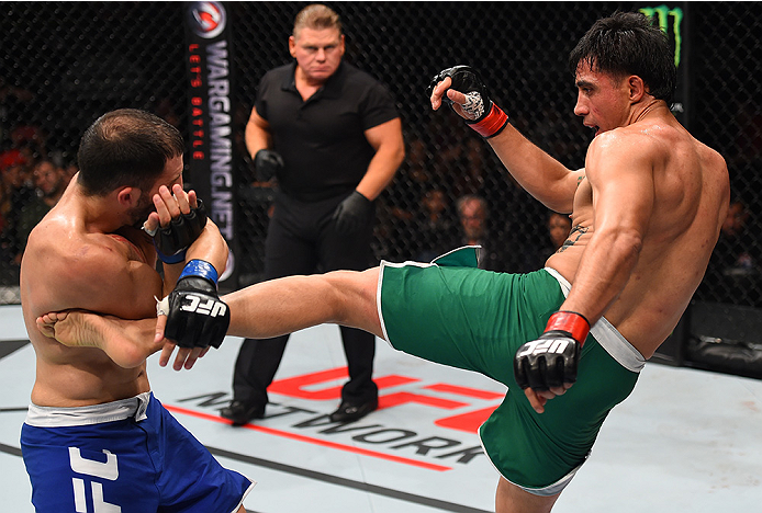 MONTERREY, MEXICO - NOVEMBER 21:  (R-L) Erick Montano of Mexico kicks Enrique Marin of Spain in their welterweight bout during the UFC Fight Night event at Arena Monterrey on November 21, 2015 in Monterrey, Mexico.  (Photo by Jeff Bottari/Zuffa LLC/Zuffa