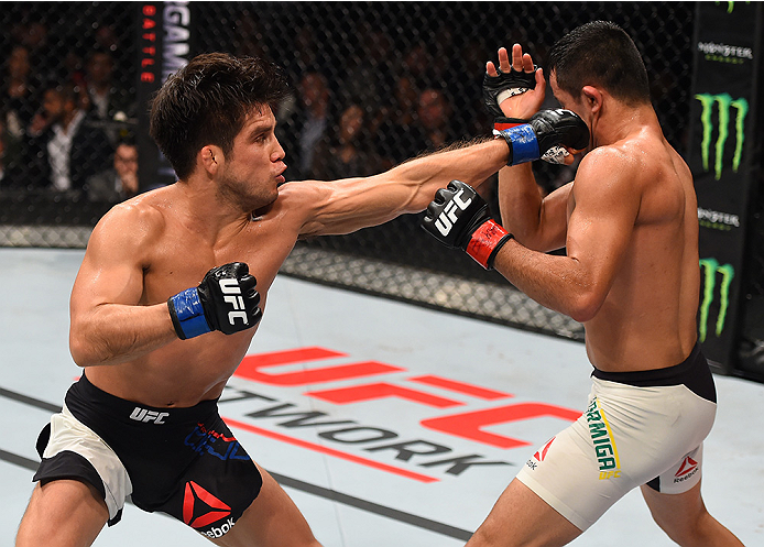MONTERREY, MEXICO - NOVEMBER 21:  (L-R) Henry Cejudo of the United States punches Jussier Formiga of Brazil in their flyweight bout during the UFC Fight Night event at Arena Monterrey on November 21, 2015 in Monterrey, Mexico.  (Photo by Jeff Bottari/Zuff