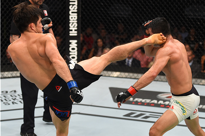 MONTERREY, MEXICO - NOVEMBER 21:  (L-R) Henry Cejudo of the United States kicks Jussier Formiga of Brazil in their flyweight bout during the UFC Fight Night event at Arena Monterrey on November 21, 2015 in Monterrey, Mexico.  (Photo by Jeff Bottari/Zuffa