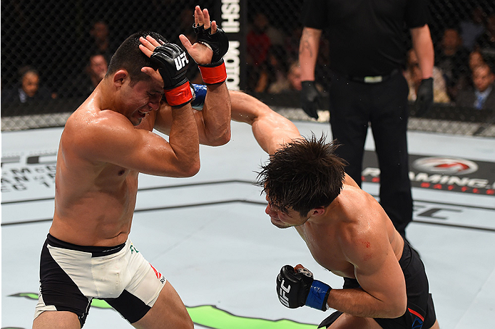 MONTERREY, MEXICO - NOVEMBER 21: (R-L) Henry Cejudo of the United States punches Jussier Formiga of Brazil in their flyweight bout during the UFC Fight Night event at Arena Monterrey on November 21, 2015 in Monterrey, Mexico.  (Photo by Jeff Bottari/Zuffa