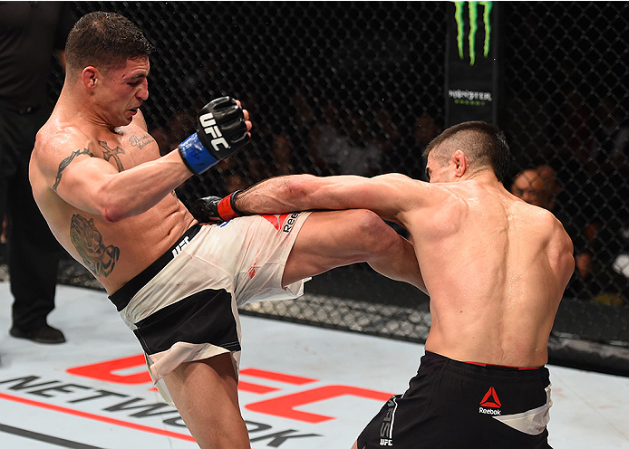 MONTERREY, MEXICO - NOVEMBER 21:  (L-R) Diego Sanchez of the United States kicks Ricardo Lamas of the United States in their featherweight bout during the UFC Fight Night event at Arena Monterrey on November 21, 2015 in Monterrey, Mexico.  (Photo by Jeff