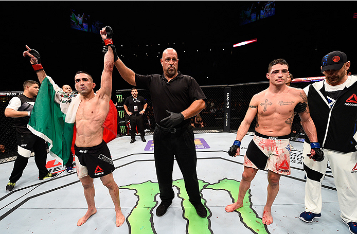 MONTERREY, MEXICO - NOVEMBER 21:  Ricardo Lamas of the United States celebrates after his decision victory over Diego Sanchez of the United States in their featherweight bout during the UFC Fight Night event at Arena Monterrey on November 21, 2015 in Mont