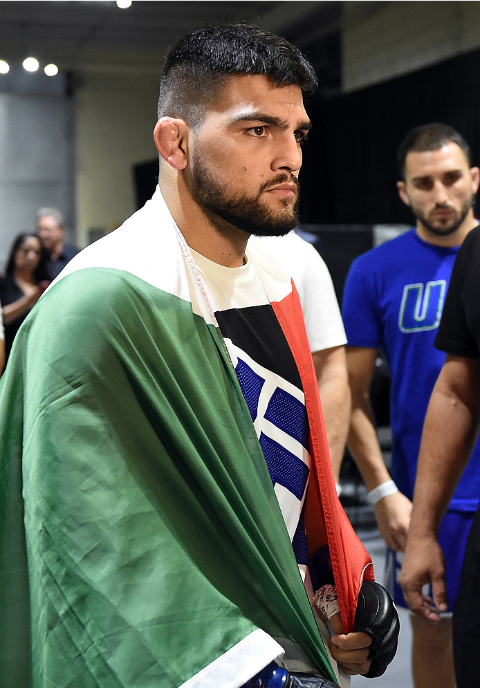 MONTERREY, MEXICO - NOVEMBER 21:  Kelvin Gastelum of the United States prepares to enter the arena before his welterweight bout against Neil Magny during the UFC Fight Night event at Arena Monterrey on November 21, 2015 in Monterrey, Mexico.  (Photo by Mi