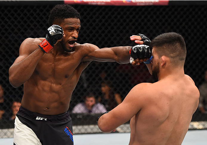 MONTERREY, MEXICO - NOVEMBER 21: (L-R) Neil Magny of the United States punches Kelvin Gastelum of the United States in their welterweight bout during the UFC Fight Night event at Arena Monterrey on November 21, 2015 in Monterrey, Mexico.  (Photo by Jeff B