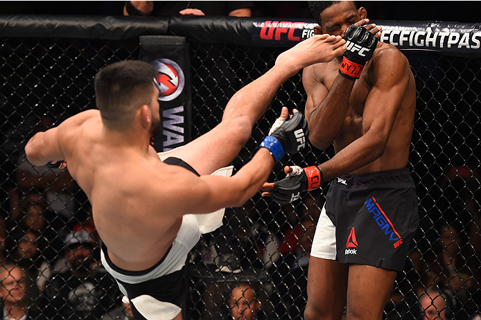 MONTERREY, MEXICO - NOVEMBER 21:  (L-R) Kelvin Gastelum of the United States kicks Neil Magny of the United States in their welterweight bout during the UFC Fight Night event at Arena Monterrey on November 21, 2015 in Monterrey, Mexico.  (Photo by Jeff Bo